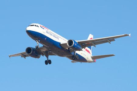 british weather: SAINT PETERSBURG, RUSSIA - MARCH 20, 2016: Airbus A320-232 (G-EUYM) British Airways on a background of blue sky