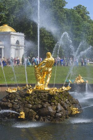 petergof: SAINT PETERSBURG, RUSSIA - JULY 03, 2015: Samson, tearing the lions mouth - the sculpture of the Big cascade fountain