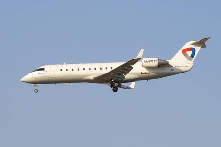 bombardier: SAINT PETERSBURG, RUSSIA - MARCH 28, 2016: Aircraft Bombardier CRJ-200LR (RA-67239) aviation enterprise Severstal before landing in Pulkovo airport