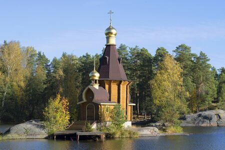 apostle: The Church of St Andrew the Apostle on Vuoksi river close-up of golden autumn. Priozersky district, Leningrad region, Russia