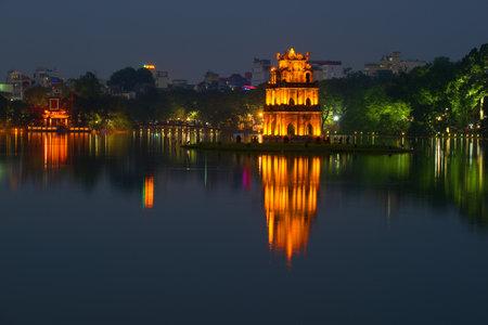 returned: HANOI, VIETNAM - DECEMBER 13, 2015: Panorama of lake of the Returned Sword in the twilight. The historical center of Hanoi Editorial