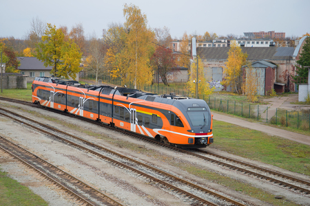 diesel train: NARVA, ESTONIA - OCTOBER 12, 2014: A modern passenger diesel train on the line at Narva Editorial