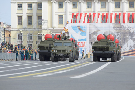 armored car: SAINT PETERSBURG, RUSSIA - MAY 05, 2015: The armored car Tiger and a column of launchers of anti-aircraft s-300pm go to the Palace square. Rehearsal of parade in honor of Victory Day in St. Petersburg
