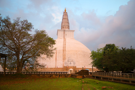 dagoba: The ancient Dagoba Ruwanwelisaya in the rays of the setting sun. Anuradhapura, Sri Lanka