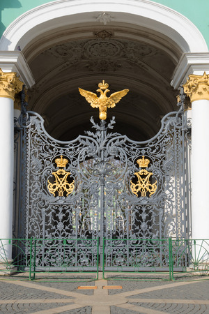 doubleheaded: Wrought iron grille gate with the imperial double-headed eagle and the monogram on the entrance of the Winter Palace