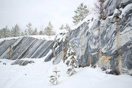 karelia: Cloudy winter day in an old marble quarry. Ruskeala, Karelia Stock Photo