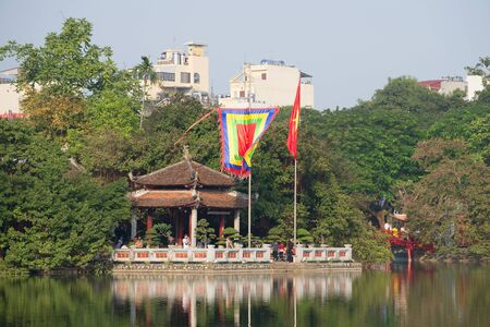 returned: HANOI, VIETNAM - DECEMBER 13, 2015: The Temple of the Jade Mountain on lake Joaquim
