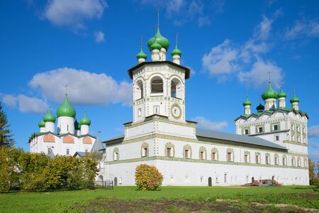 theological: Bell Tower and the Church of St. John the Evangelist in Vyazhishchsky Monastery, sunny october afternoon. Novgorod region, Russia Stock Photo