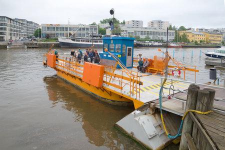 aura: TURKU, FINLAND - JUNE 12, 2014: Ferry Fiori is preparing to ferry people across the river Aura