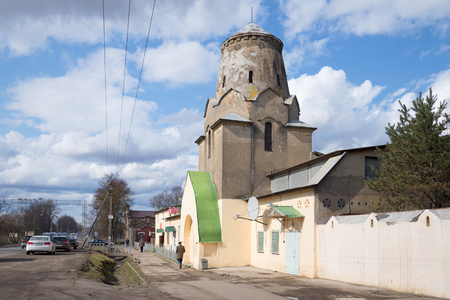 turret: LENINGRAD REGION, RUSSIA - APRIL 24, 2016: The building is an old coaching inn with a turret, remodeled as a shop Pyaterochka. Vilozen, Leningrad