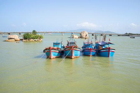 trang: NHA TRANG, VIETNAM - DECEMBER 30, 2015: Four fishing schooners anchored at the mouth of the Cai river. Nha Trang, Vietnam Editorial