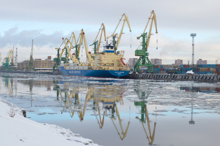 reefer: SAINT PETERSBURG, RUSSIA - FEBRUARY 17, 2016: The ship Baltic spring is unloaded at the cargo port, february morning. The Gunboat canal