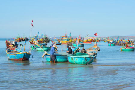 december 25: MUI NE, VIETNAM - DECEMBER 25, 2015: Fishermen are preparing to go to sea to fish in the Fishing harbour of Mui Ne