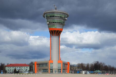dispatch: MOSCOW, RUSSIA - APRIL 15, 2015: The building of the control tower (KDP) to Sheremetyevo international airport under a cloudy sky