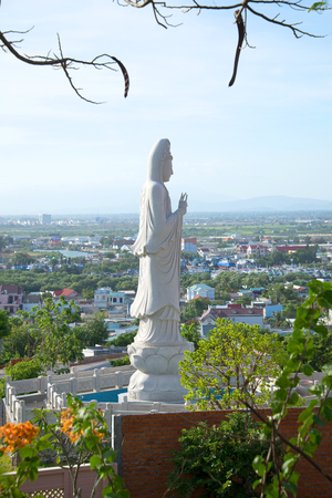 bodhisattva: View of the sculpture of the Bodhisattva Avalokitesvara (Goddess of Mercy) in the early evening. Phan Thiet, Vietnam