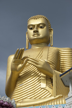 buddha sri lanka: Buddha statue, cloudy day. Dambulla, Sri Lanka Stock Photo