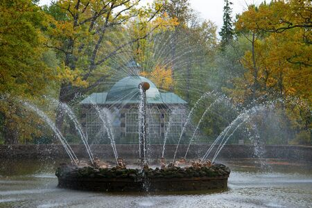 desolated: SAINT PETERSBURG, RUSSIA - OCTOBER 05, 2015: Fountain the Sun in the autumn Peterhof