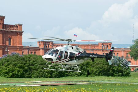 helicopter pad: SAINT PETERSBURG, RUSSIA - MAY 22, 2016: The take-off of a private helicopter Bell 407GX (RA-01605) from the helicopter pad at the Peter and Paul fortress Editorial