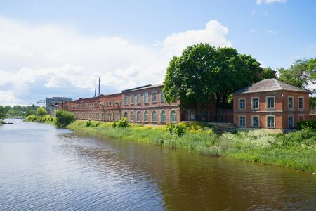 The view on the old corps Nevsky shipyard from the river Lamanca. Shlisselburg Stock Photo