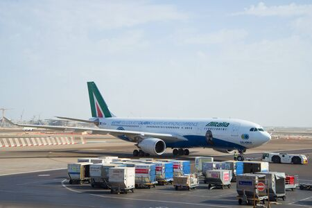 msn: ABU DHABI, UAE - MARCH 27, 2015: Towing Aircraft Airbus A330 - MSN 1123 (EI-EJG) of Alitalia after landing at the airport in Abu Dhabi