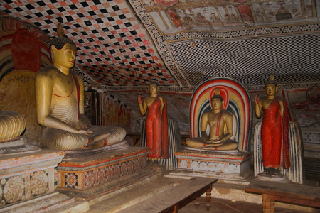 Ancient Buddha sculptures in the cave Golden Temple. Dambulla, Sri Lanka