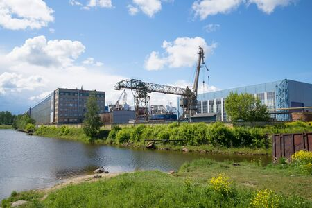 SHLISSELBURG, RUSSIA - JUNE 05, 2016: View of the Nevsky shipbuilding factory, sunny june day