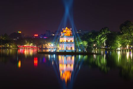 ancient turtles: HANOI, VIETNAM - JANUARY 10, 2016: Night on Hoan Kiem lake. View on the Tower Turtles and red bridge Editorial