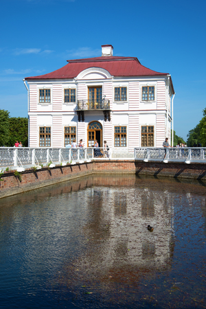 sectoral: SAINT PETERSBURG, RUSSIA - JULY 03, 2015: The Marly Palace with reflection in pond closeup. Peterhof