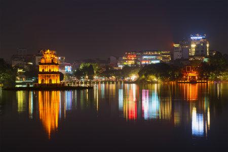 returned: HANOI, VIETNAM - DECEMBER 13, 2015: Night panorama of the lake of the returned sword. The historical center of Hanoi