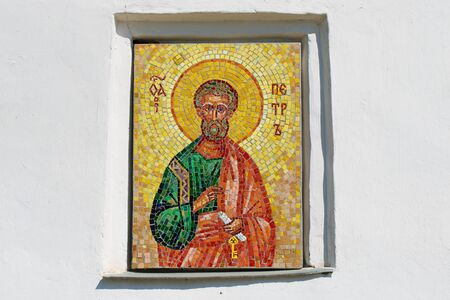 PSKOV, RUSSIA - MAY 07, 2016: Mosaic icon of the Apostle Peter on the wall of a medieval Church of the Apostles Peter and Paul Editorial