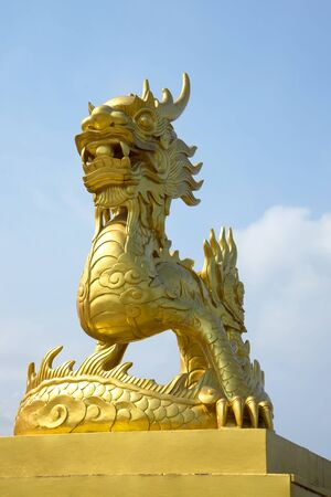 hue: Golden statue of a dragon in the forbidden Purple city Hue, Vietnam Stock Photo