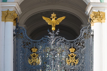 doubleheaded: Fragment of the main gate with the Imperial monogram double-headed eagle at the entrance to the Winter Palace. Saint Petersburg Editorial