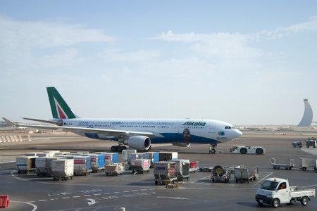 msn: ABU DHABI, UAE - MARCH 27, 2015: The Airbus A330 - MSN 1123 (EI-EJG) Alitalia on the apron of airport Abu Dhabi