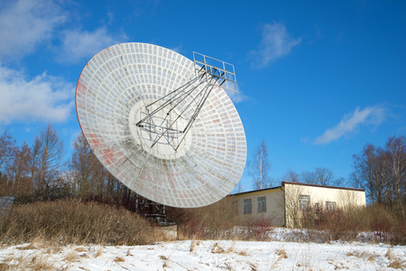 astrophysical: The radio telescope at the building of the astrophysical laboratory of the sunny february day. Pulkovo astronomical observatory, Saint Petersburg