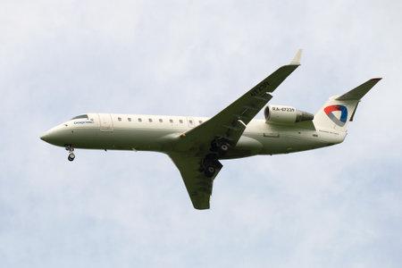 ST. PETERSBURG, RUSSIA - JUNE 24, 2016: Bombardier CRJ-200LR ( RA-67239) aviation enterprise Severstal close-up cloudy sky