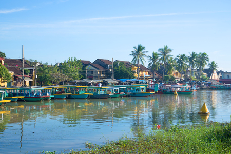 hoi an: HOI AN, VIETNAM - JANUARY 04, 2016: Early morning on the Thu Bon river. The historic town centre of Hoi An