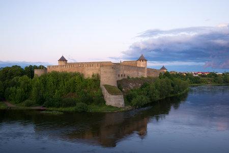 leningrad: View of the Ivangorod fortress in the summer twilight. Leningrad region, Russia