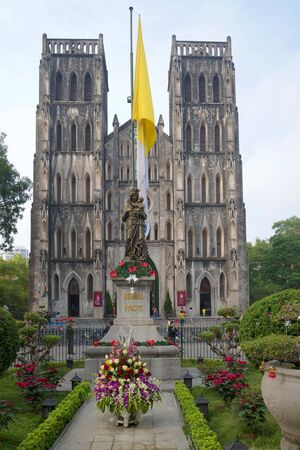 st  joseph: HANOI, VIETNAM - JANUARY 10, 2016: Old catholic cathedral of St. Joseph cloudy morning