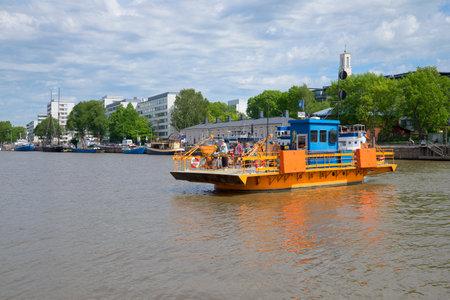 aura: TURKU, FINLAND - JUNE 13, 2015: Passenger ferry Fiori crossing the river Aura Editorial