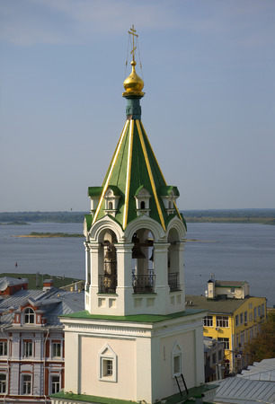 tent city: The belfry of the old Church of St. John the Baptist on the background of the Volga river close up. Nizhny Novgorod Stock Photo
