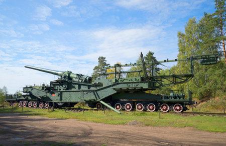 conveyor rail: LENINGRAD REGION, RUSSIA - SEPTEMBER 14, 2015: 305-mm gun mount on the rail conveyor. Fort Krasnaya Gorka (Krasnoflotsk) Editorial