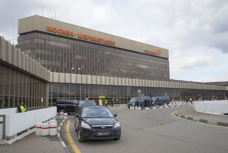 f 15: MOSCOW, RUSSIA - APRIL 15, 2015: Terminal F of Sheremetyevo international airport, cloudy april day. Tourist landmark of the city Moscow Editorial