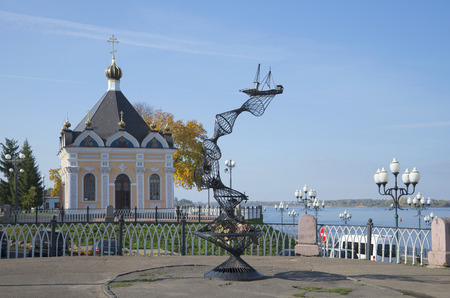 yaroslavl: The monument to fishermen and the chapel of St. Nicholas on the Volga embankment. Historical landmark of the city Rybinsk