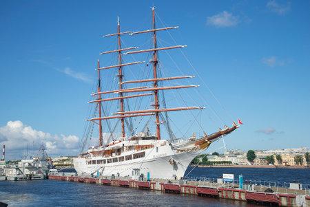 cloude: SAINT PETERSBURG, RUSSIA - JULY 25, 2015: Sailing ship Sea Cloud II moored at the English promenade, a sunny summer day. Tourist landmark of the city Saint Petersburg
