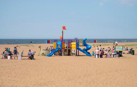 children play area: ZELENOGORSK, RUSSIA - JUNE 21, 2015: Children play area on the beach of the Gulf of Finland Editorial