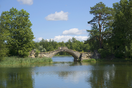 Humpback bridge (Bridge between Islands) on White lake. Gatchina, Russia Stok Fotoğraf