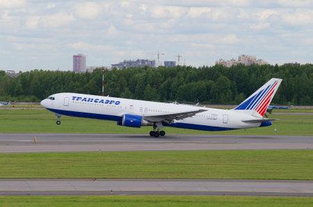 SAINT PETERSBURG, RUSSIA - JULY 24, 2015: Flying the Boeing 767-300ER (EI-RUZ) of the company Transaero. Pulkovo Airport Redakční