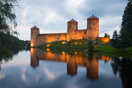 View of the fortress Olafsborg in the summer twilight. Savonlinna, Finland