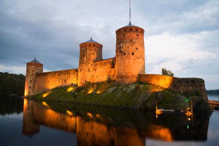 Fortress Olavinlinna in the summer twilight. Savonlinna, Finland