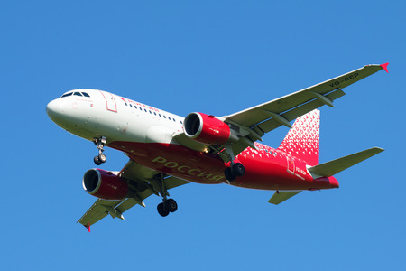 SAINT PETERSBURG, RUSSIA - AUGUST 24, 2016: Airbus A319-111 (VQ-BCP) of the airline Rossiya - Russian Airlines largest plan in the blue sky